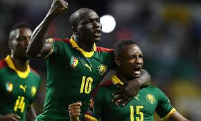Cameroon striker celebrating after scoring