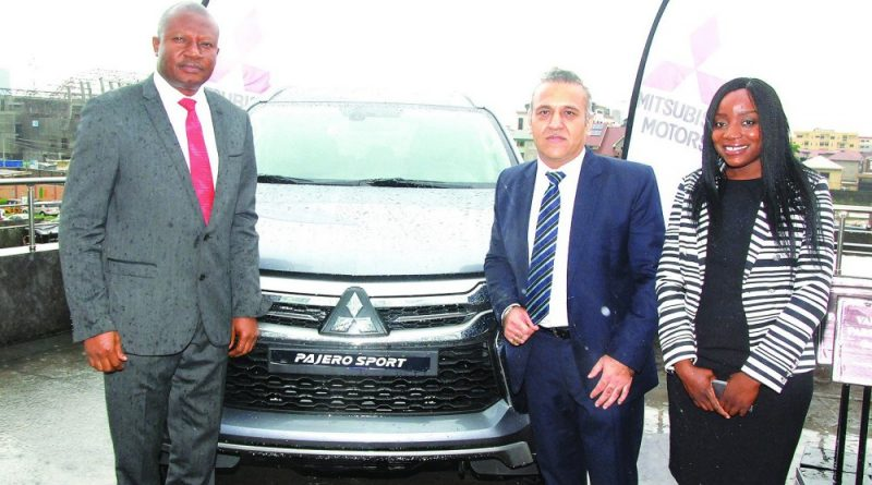 Pix from left Mr Kunle Jaiyesimi, Deputy Managing Director; Navin Chander, GM, Sales and Marketing and Funmi Abiola, Marketing Manager all of Massilia Motors suring the launch of the New Mitsubishi Pajero sport by Massilia Motors Ltd in Lagos on Thursday