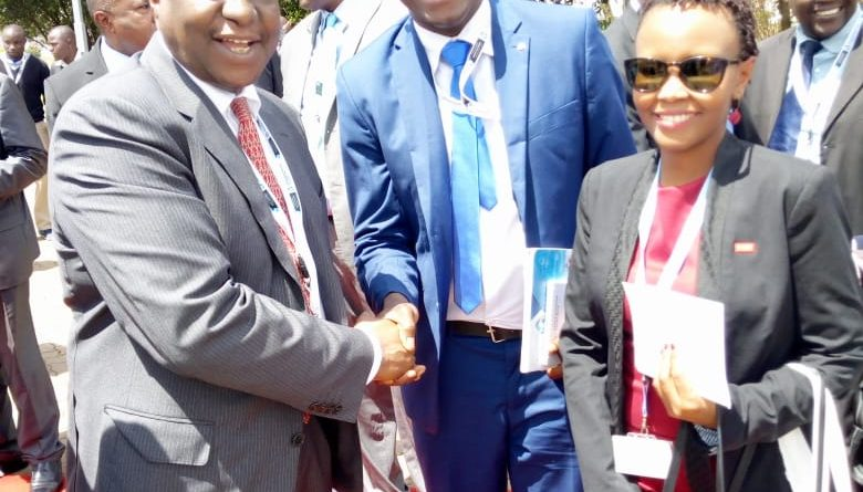 Jared Oundo with the minister of Treasury CS Henry Rotich