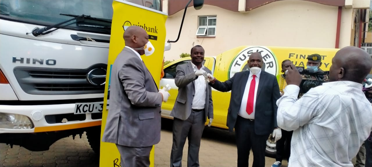 John Mogire of Quipbank hands over the Keys to Narok Govenor, looking is the Narok CEC Health